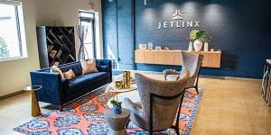 The member lounge at Jet Linx Chicago boasts warm touches and fine finishes.