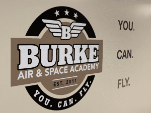 Burke Air and Space Academy Poster on the wall and slogan.