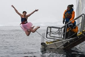 Jet Linx safety specialist jump into ocean while supporting The Tutu Project