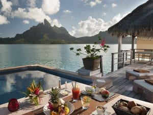 st regis bora bora bungalow overlooking ocean and mountain