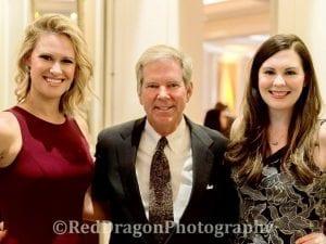 Maggie Shephard, John Snodgrass, and Meghan Hogan at a Gala.
