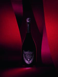 dom perignon vintage rose 2006 bottle surrounding by blush colors