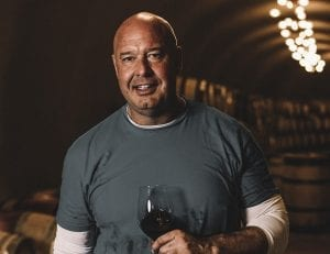 PerUs head winemaker mike bevan holding a glass of red wine in the perus cellars