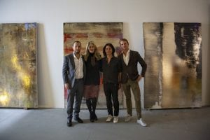 Isaac Flanagan, Elizabeth Margulies, Nir Hod, and Alec LeFort pose in front of Hod's collection