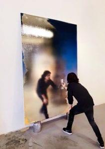 Artist Nir Hod creates a piece of work in his New York studio