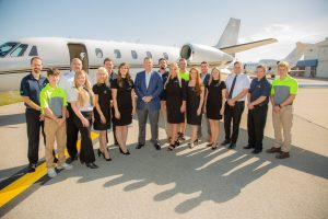 jet linx indianapolis team members posing in front of jet on runway